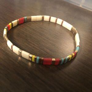 Elastic multi coloured bracelet